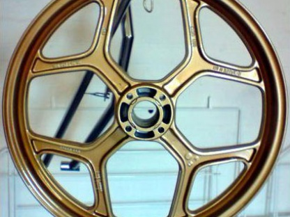 Bike Wheel Coated in Gold and Lacqure Powder
